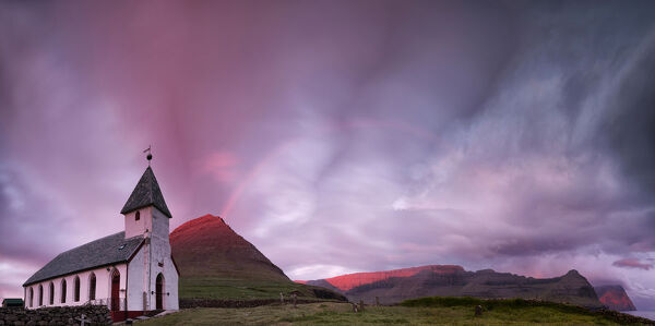 Panoramic of church of Vidareidi at sunrise, Vidoy island, Faroe Islands, Denmark, Europe