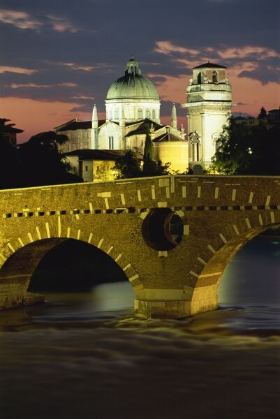 The Ponte Pietra Bridge and Adige River at dusk in the town of Verona, Veneto, Italy, Europe