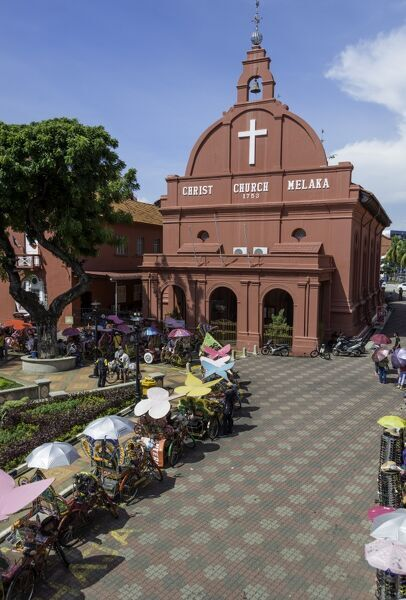 Rickshaws outside Christ Church in the town square, Melaka (Malacca), UNESCO World Heritage Site