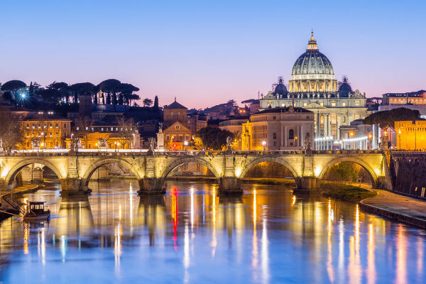 St. Peters Basilica and the Vatican with Ponte St Angelo over the River Tiber at dusk, Rome, Lazio, Italy, Europe