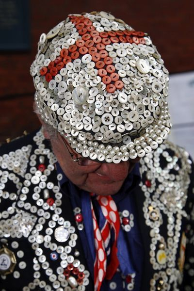 The Pearly King of Bow Bells wearing a red cross pearl button hat at the Pearly King and Queen second Harvest Festival, St. Paul's Church, Covent Garden. Pearly Kings and Queens attended the church service raising money for charity