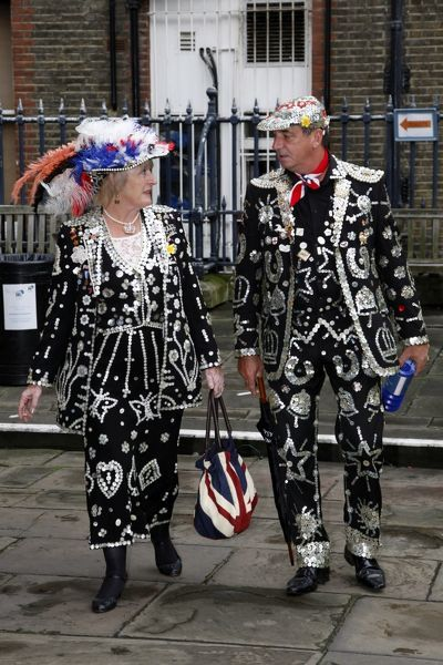 The Pearly Queen of Merton and the Pearly King of Wapping at the Pearly King and Queen second Harvest Festival, St. Paul's Church, Covent Garden. Pearly Kings and Queens attended the church service raising money for charity