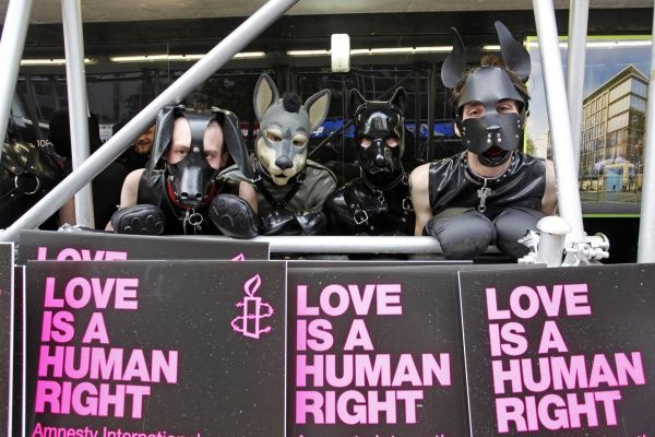 London, UK. 7th July 2012. Participants dressed in rubber as dogs marching in World Pride 2012, London, England