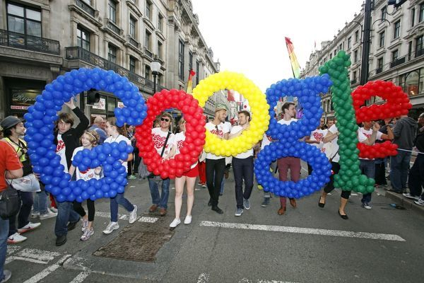 London, UK. 7th July 2012. Members of Google spelling out the name in balloons marching in World Pride 2012, London, England