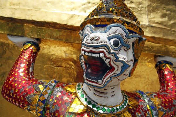 Ugly and grotesque face masks on statues in the Grand Palace Complex, Wat Phra Kaew, Bangkok, Thailand