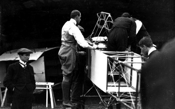 Claude Grahame-White overseeing the erection of his Bleriot monoplane, prior to the Bournemouth Meeting, July 1910. (Pub 26Nov10)