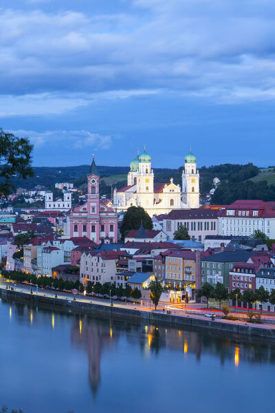 Elevated view towards the picturesque city of Passau illuminated at dusk, Passau, Lower Bavaria, Bavaria, Germany