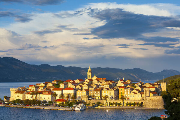 Elevated view over picturesque Korcula Town illuminated at sunset, Korcula, Dalmatia