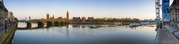 The Houses of Parliament & The River Thames illuminated at dawn