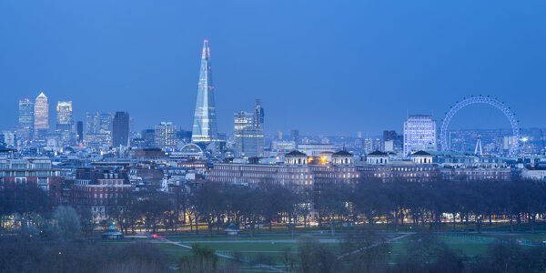 The Shard, Canary Wharf and London Eye above Hyde Park, London, England, UK