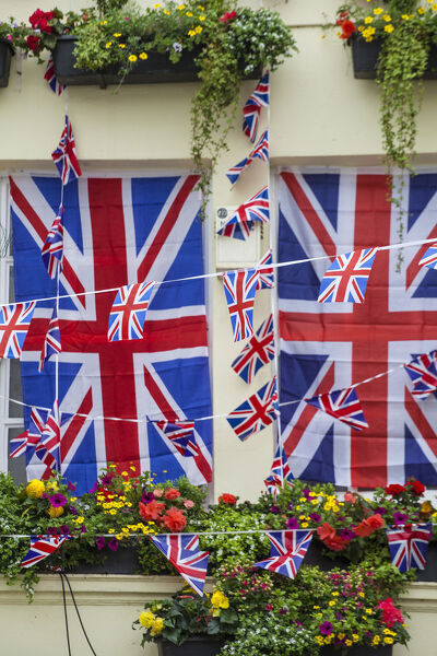 UK, England, London, Kensington, The Churchill Arms Pub with Union Jack bunting to