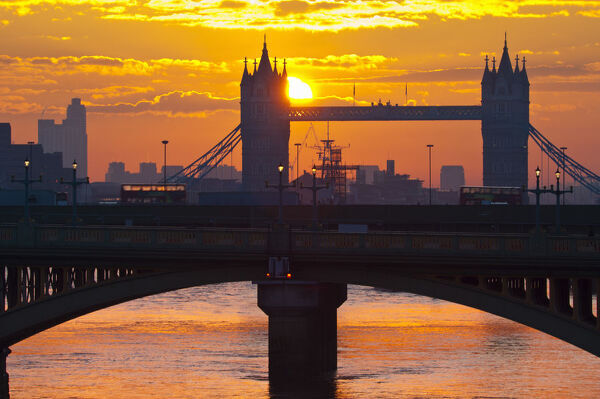 UK, England, London, Southwark Bridge and Tower Bridge at sunrise