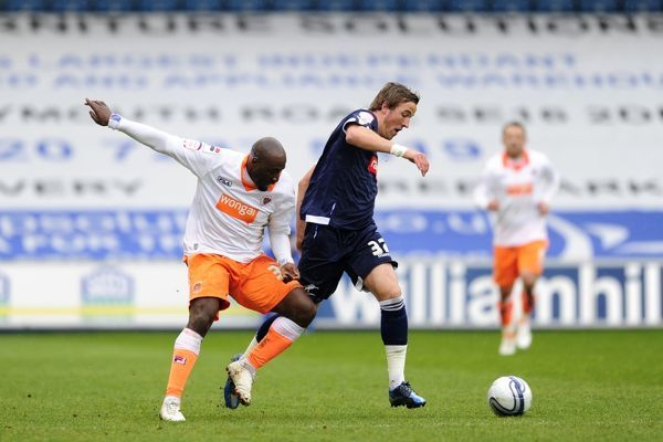 Millwall's Harry Kane (right) and Blackpool's Lomana Tresor LuaLua battle for the ball