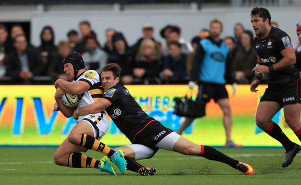 Wasps' Rob Miller (left) is tackled by Saracen's Chris Wyles (right) during the Aviva Premiership match at Allianz Park, London