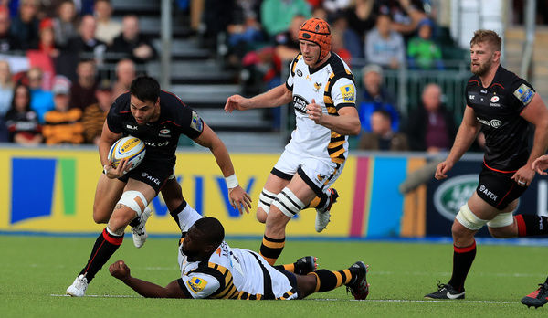 Saracen's Sean Maitland (left) is tackled by Wasps' Simon McIntyre during the Aviva Premiership match at Allianz Park, London