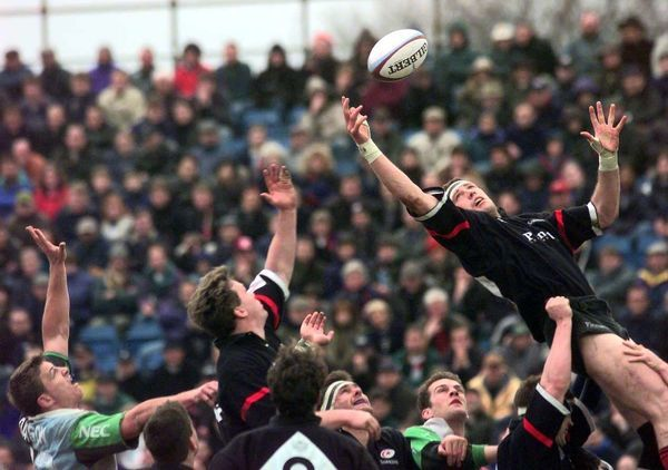 Michael Lynagh (left, black shirt) and Paddy Johns from Saracens stretch for the ball during their Pilkington Cup quarter final match against Harlequins at the Stoop Memorial Ground this afternoon (Sunday). Photo by Adam Butler/PA
