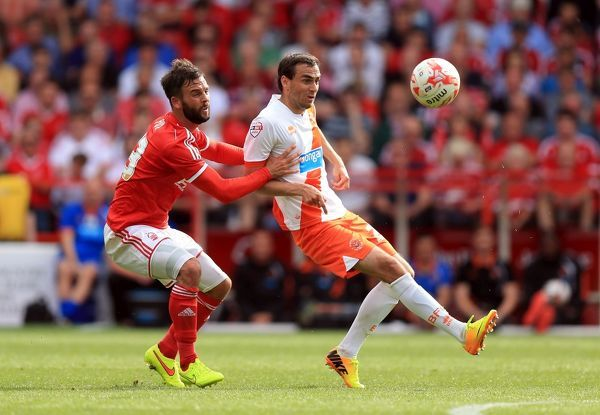 Blackpool's Sergei Zenjov (right) and Nottingham Forest's Danny Fox battle for the ball during the Sky Bet Championship match at the City Ground, Nottingham. PRESS ASSOCIATION Photo