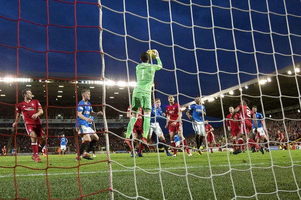 Aberdeen's goalkeeper Joe Lewis catches the ball during the Ladbrokes Premiership match at Pittodrie Stadium, Aberdeen