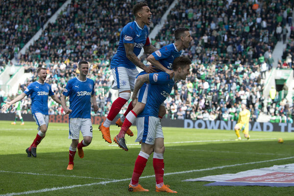 Rangers' Jason Holt jumps on the back of goal scorer Josh Windass after his shot deflected of him into the net during the Ladbrokes Premiership match at Easter Road, Edinburgh