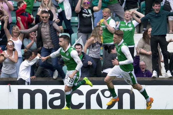 Hibernian's Jamie MacLaren celebrates his third goal and his side's fifth during the Ladbrokes Premiership match at Easter Road, Edinburgh