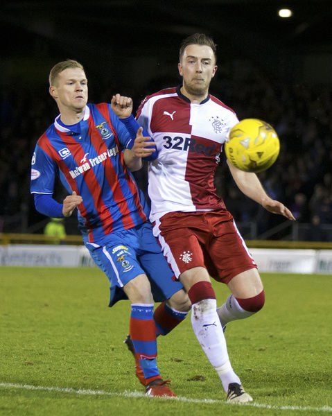 Rangers' Danny Wilson shoves Inverness' Louis Laing during the Ladbrokes Premiership match at the Tulloch Caledonian Stadium, Inverness