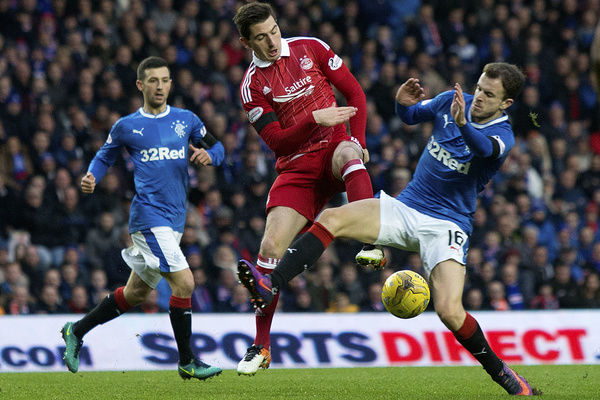 Rangers' Andy Halliday tackles Aberdeen's Kenny McLean during the Ladbrokes Premiership match at Ibrox Stadium, Glasgow