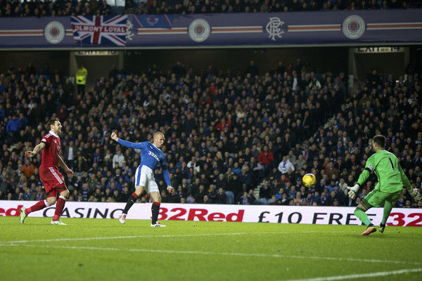 Rangers' Kenny Miller scores during the Ladbrokes Premiership match at Ibrox Stadium, Glasgow