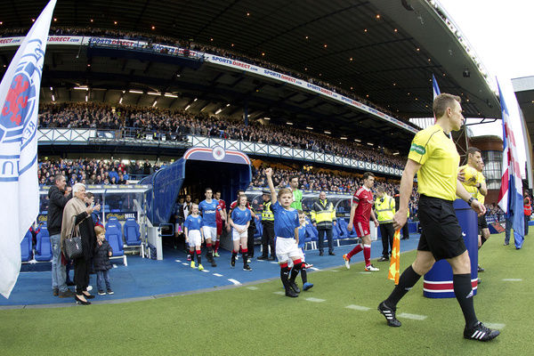 Rangers captain Lee Wallace leads out the players and mascots during the Ladbrokes Premiership match at Ibrox Stadium, Glasgow