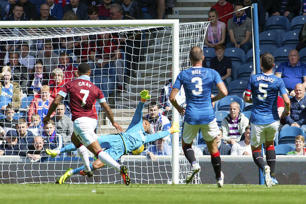 Burnley's Andre Gray scores his second goal from the penalty spot during the friendly match at Ibrox Stadium, Glasgoww