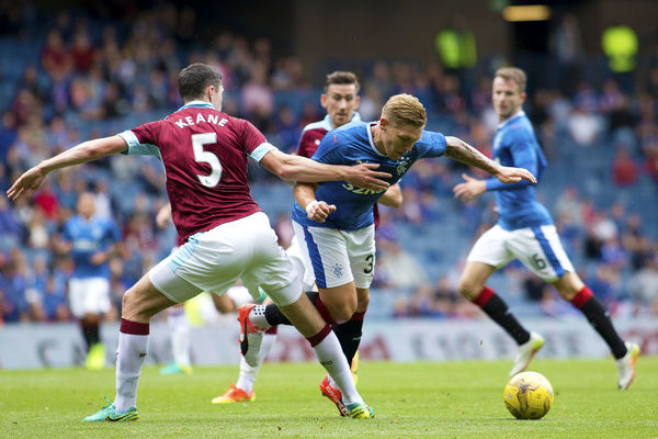 Rangers' Martyn Waghorn and Burnley's Michael Keane during the friendly match at Ibrox Stadium, Glasgoww