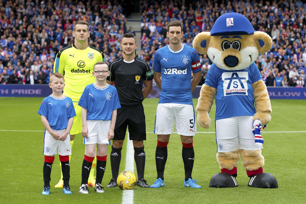 Rangers captain Lee Wallace and mascots during the friendly match at Ibrox Stadium, Glasgoww