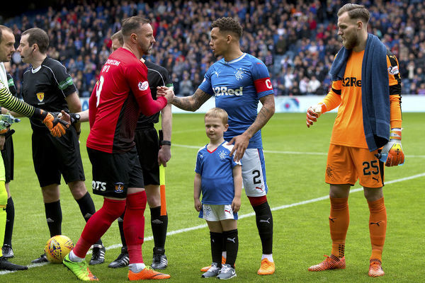 Rangers captain James Tavernier with a mascot during the Ladbrokes Premiership match at Ibrox Stadium, Glasgow