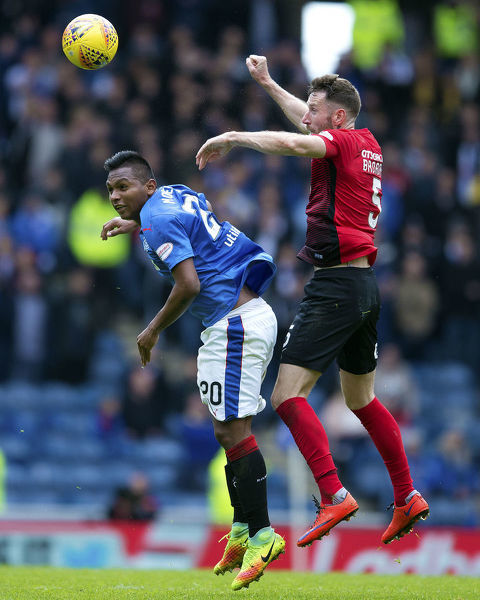 Rangers' Alfredo Morelos jumps with Kilmarnock's Kirk Broadfoot during the Ladbrokes Premiership match at Ibrox Stadium, Glasgow