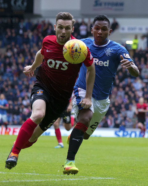 Rangers' Alfredo Morelos and Kilmarnock's Stephen O'Donnell chase the ball during the Ladbrokes Premiership match at Ibrox Stadium, Glasgow