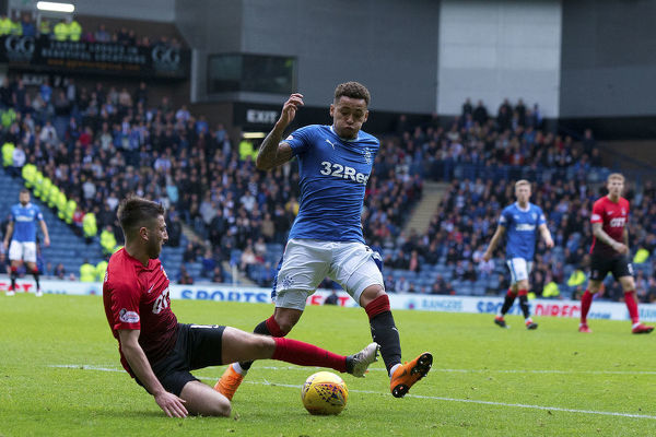 Rangers' James Tavernier is tackled off Kilmarnock's Greg Taylor during the Ladbrokes Premiership match at Ibrox Stadium, Glasgow