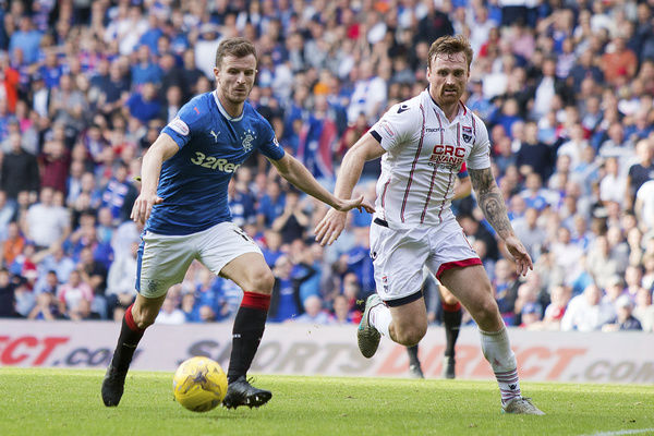 Rangers' Andy Halliday and Ross County's Martin Woods during the Ladbrokes Premiership match at Ibrox Stadium, Glasgow