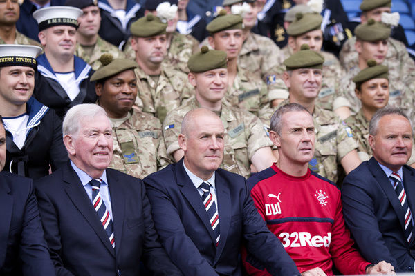 Rangers manager Mark Warburton and assistant manager Davie Weir pose for a picture with members of the Armed Forces the Ladbrokes Premiership match at Ibrox Stadium, Glasgow