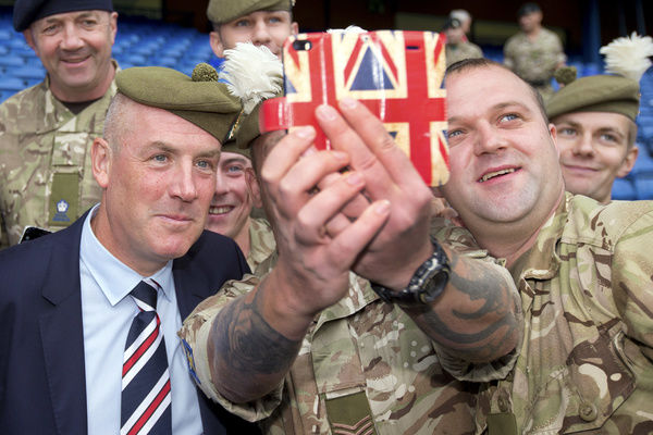 Rangers manager Mark Warburton meets members of the Armed Forces prior to kick off at the Ladbrokes Premiership match at Ibrox Stadium, Glasgow