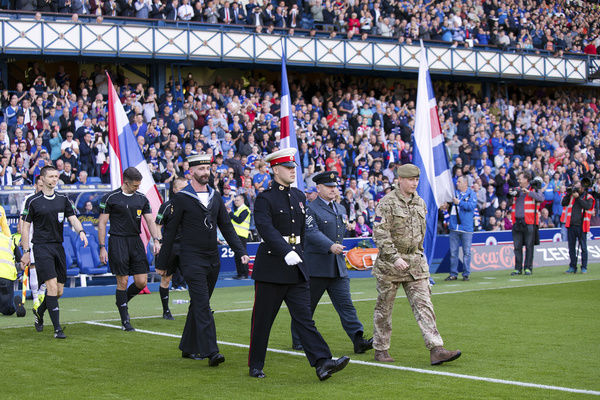 Members of the Armed Forces prior to kick off at the Ladbrokes Premiership match at Ibrox Stadium, Glasgow