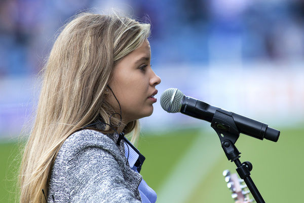 Megan Adams sings prior to kick off at the Ladbrokes Premiership match at Ibrox Stadium, Glasgow