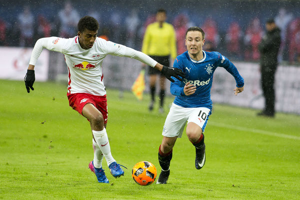 Rangers' Barrie McKay chases the ball with Leipzig's Bernardo during the friendly match at the Red Bull Arena in Leipzig, Germany