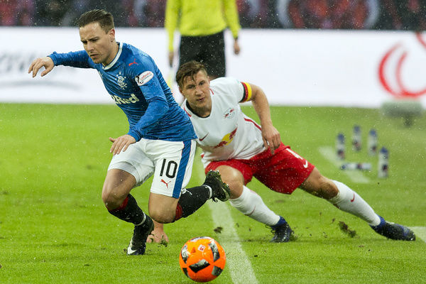 Rangers' Barrie McKay is fouled by Leipzig's Willi Orban during the friendly match at the Red Bull Arena in Leipzig, Germany
