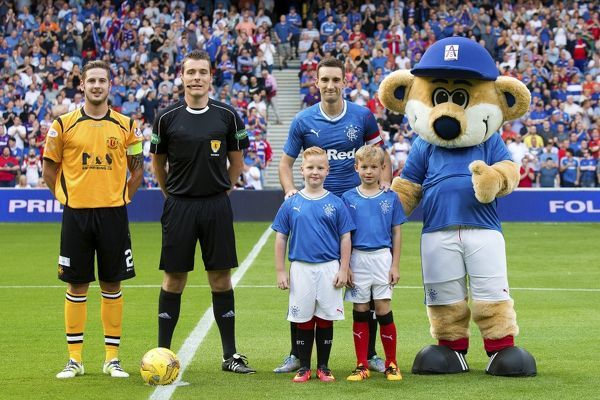 Rangers captain Lee Wallace and macots during the Betfred Cup tie at Ibrox Stadium, Glasgow