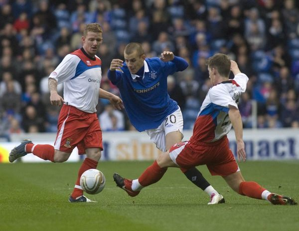 Rangers' Vladimir Weiss is tackled by Inverness' Kevin McCann