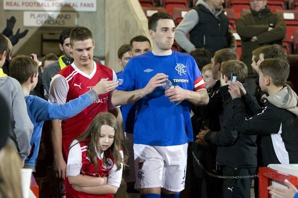 Rangers captain Lee Wallace and Stirling Albion captain Brian Allison lead out their players