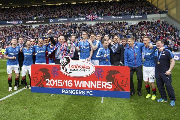 Rangers manager Mark Warburton, captain Lee Wallace and players celebrate with the Ladbrokes Championship Trophy at Ibrox Stadium, Glasgow