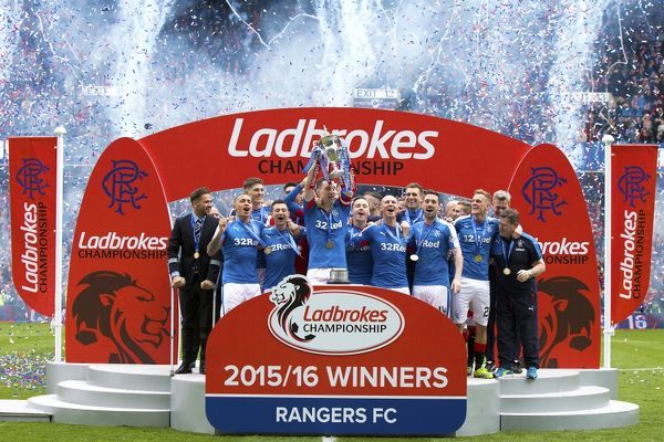 Rangers captain Lee Wallace lifts the Ladbrokes Championship Trophy at Ibrox Stadium, Glasgow