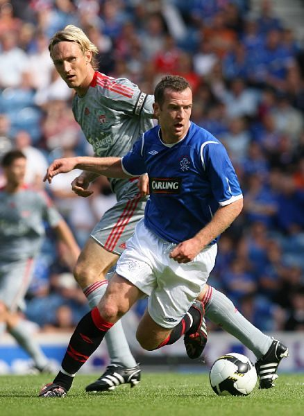 Rangers' Charlie Adam in action with Liverpool Sami Hyypia