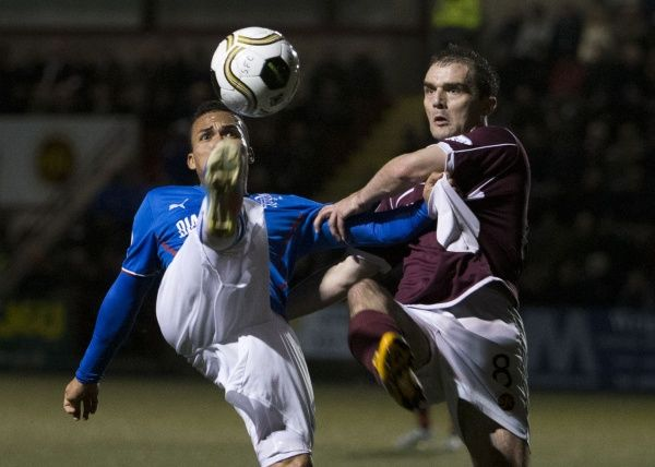 Rangers' Arnold Peralta and Stenhousemuir's David Rowson battle for the ball