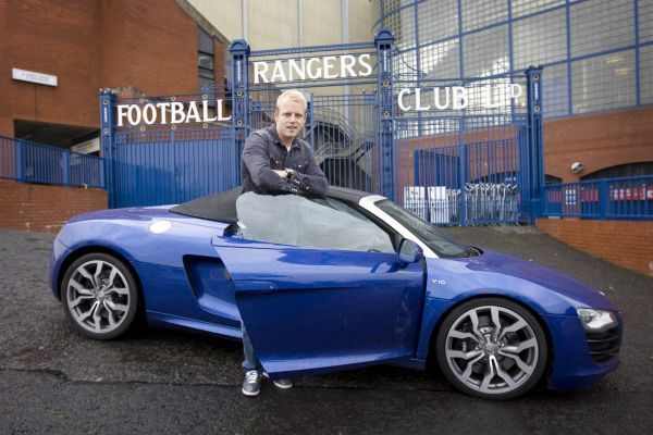 Rangers' Steven Naismith tests drive the new Audi R8 sports car